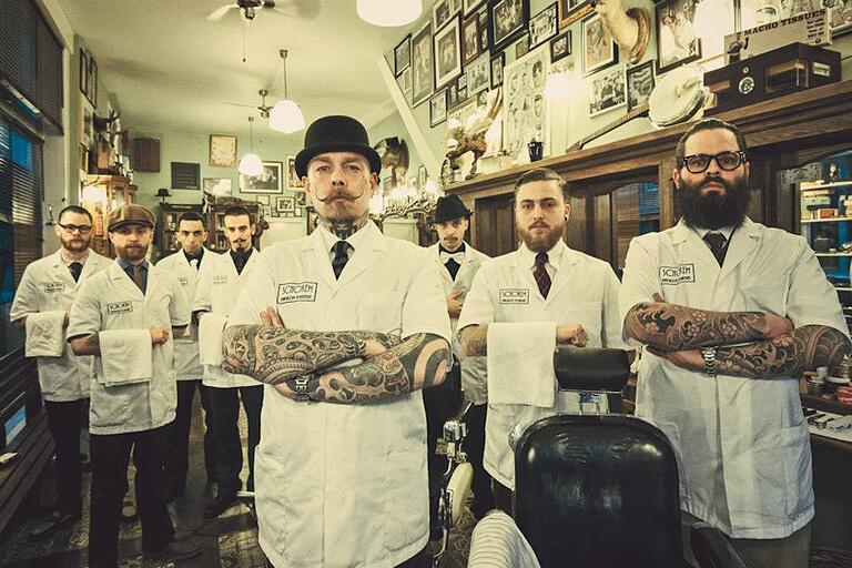 8 barbers in a traditional barbershop