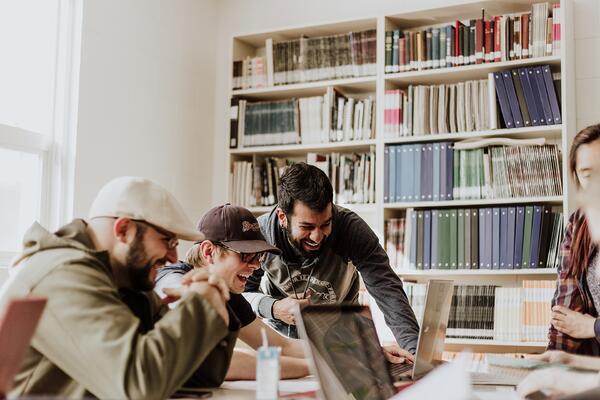three men having fun during a hackathon