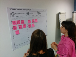two women looking at a lean startup poster