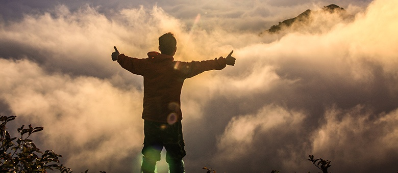 guy standing on top of a mountain