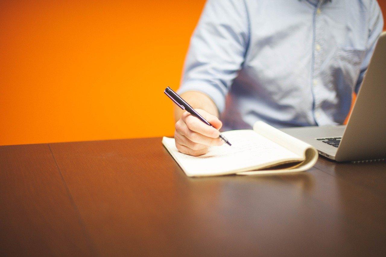 scenario-planning-man-with-laptop-pen-notepad